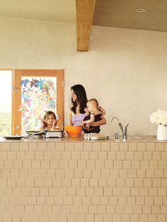 The home features earthy, tactile materials, such as natural tile, wood, and hand-finished plaster.