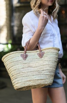 Straw tote bag, white shirt and denim cut offs