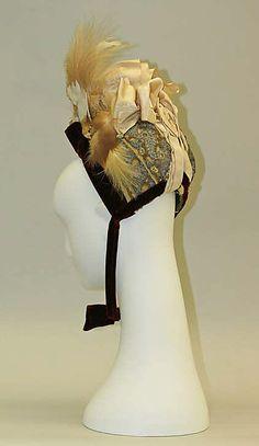 Bonnet.  Date: 1886–89. Culture: American. Medium: silk, feathers, metal. Dimensions: Height: 11 in. (27.9 cm).