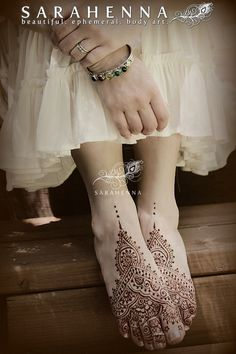 Boho style henna feet weave the design into each other