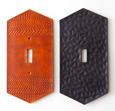 Hand tooled leather light switch plate featuring a herringbone pattern at top and bottom. Leather (available in black or chestnut, select below) is hand tooled and dyed with a metal plate backing.