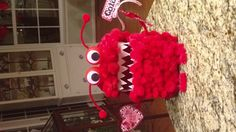 Valentines day Monster box for treats. Made from a box and some pom poms, and scrap paper.
