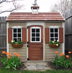 I had a playhouse very similar to this one when I was a kid. It was designed from an old pump house.    It had a dutch-door, handmade shutters and a redwood porch with a decent sized flower garden.    The inside of my playhouse wasn't real fancy -- but it was fun to have and play in during the summer months.
