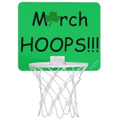 """""""March HOOPS"""" Original Slogan.  A Shamrock is in place of the letter a.  Fun Mini Basketball Goal Hoop for male or female to practice your hoop throwing.  Change BACKGROUND Green Color to your Teams Color, if you wish.  Perfect for the office, dorm room, bedroom. Original Slogan Text saying & Graphic Artwork Design © TamiraZDesigns via:  www.zazzle.com/tamirazdesigns*"""