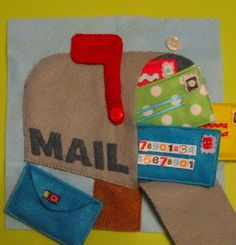 This fun little mail box holds a real letter and can be opened and closed to check for mail. http://hative.com/quiet-book-ideas-for-kids/