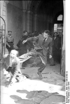 Abuse of a jew. Ukraine 1941. His face. This made me intensely sad...I just don't understand.