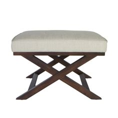 Rest your legs in style when you prop them up on this lovely bench ottoman. Crossed walnut legs provide both stability and elegance, while the white linen fabric resists wear and tear. You will appreciate the padding when reclining with sore feet.