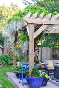 Are you planning on building a giant cedar pergola in your backyard with only your spouse as your workmate?Well before you run out to your pile of lumber with your saw and goofy grin, let me share some of the things that Mr. Suburble and I learned in our pergola building adventure!