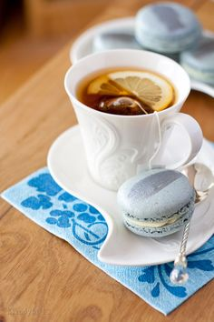 Love the cup and saucer ---- tea and blue macroons