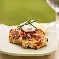 Garnish these miniature crab cakes with chives for a savory appetizer. Serve with lemon wedges.
