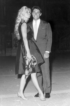 With Sacha Distel at the 19th International Film Festival of Venice on September 1, 1958.   - ELLE.com