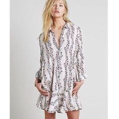 Free People Button Down Dress Free People floral button down dress. Pink floral pattern. Has pockets. Long sleeves. Has ruffle hem. Worn once for Easter. EUC. Still in stores full price. Free People Dresses