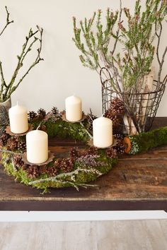 Make Advent wreath itself. DIY moss wreath for Advent with cones and a lot of n . Make Advent wreath itself. DIY moss wreath for Advent with cones and a lot of n . Christmas Wreaths, Christmas Decorations, Table Decorations, Christmas Ideas, Moss Wreath, Advent Wreath, Candle Sconces, Pillar Candles, Rustic Decor