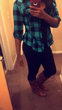Today's outfit is black skinny jeans and calf high brown boots. A black tank top with a blue and black plaid shirt to cover.