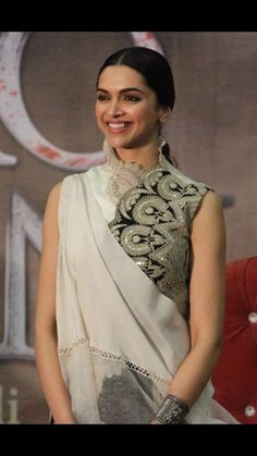 Deepika dressed up in a beautiful dress with her fav type of collar for Bajirao promotions