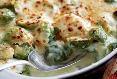 Brussel Sprouts Gratin  I hate Brussel Sprouts..trying to find recipe that will make me eat them.  CHEESE