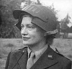 Miller wears a special helmet to accommodate her camera as a war correspondent in World War II. (The photographer is unknown.)