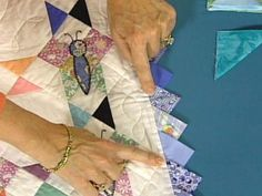 HGTV.com offers tips for folding, attaching and calculating the size of prairie point quilting borders.