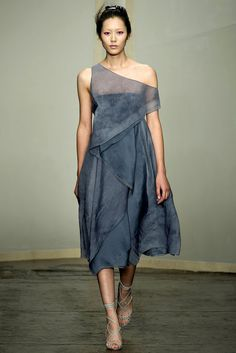Donna Karan Spring 2013 what about a simple strapless tube dress with an asymmetrical sheer triangle wrapped section like this shown here?
