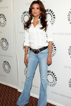 Eva Longoria in flaired jeans and a white shirt