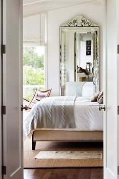 Bedroom mirror idea from 9+Small-Space+Decorating+Tricks+Designers+Swear+By+via+@MyDomaine