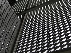 Upward shot into partial perforated metal extrusion square column with bird pattern by forestelf_2000, via Flickr