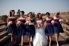 i LOVE the navy and fuchsia dresses! #bridesmaid #weddingflowers #navy #fuchsia