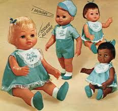 Tiny Chatty Cathy baby doll.....I had the brunette baby Cathy AND tiny baby brother. Loved them!