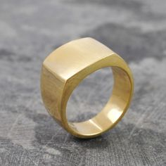 Square Signet Gold Ring for Men - This chunky solid Square Signet Gold Ring for Men, with its unique brushed textured surface is a contemporary take on a long standing classic. #Otisjaxon #Jewellery