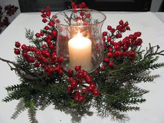 Bring a festive touch to your home with these traditional Christmas decorating ideas. Think red, gold, homemade and Nordic Christmas decorations Christmas Candle Decorations, Christmas Flower Arrangements, Christmas Swags, Holiday Centerpieces, Candle Centerpieces, Christmas Candles, Noel Christmas, Christmas Crafts, Xmas Ornaments