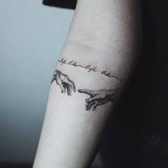 The Creation Of Adam inspired tattoo on the inner forearm.