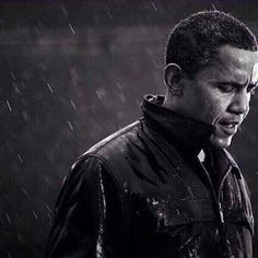 This photo is the epitome of the president weathering America's storms. | Barack Obama in the rain.