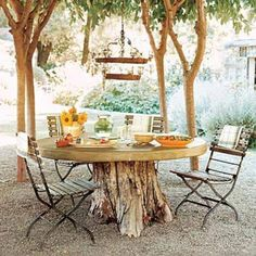 Tree stump turned dining table - If you have the space and the stump, then I can't think of a reason not to make this Secret Garden-esque table. A leveled tree stump with a DIY poured concrete top,