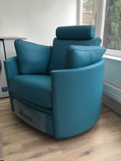 Leather covered chair that rocks, reclines and swivels. The curved arms give this electric chair a very contemporary twist.