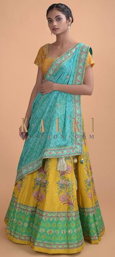 Buy Online from the link below. We ship worldwide (Free Shipping over US$100)  Click Anywhere to Tag Corn Yellow Lehenga In Silk With Floral Print And Hand Embroidery Online - Kalki Fashion Corn yellow lehenga in silk with floral print and hand embellished with pita zari, sequins and cut dana work.Hemline enhanced with repeat pattern.It comes with a turq blue silk printed dupatta with embellished buttis and border with tassels on the corner Embroidery Online, Hand Embroidery, Yellow Lehenga, Anarkali, Indian Wear, Salwar Kameez, Hemline, Tassels, Floral Prints