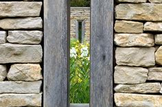 """""""...a Georgian Rectory in the Cotswolds: new dry stone walls with weathered timber framed openings."""""""