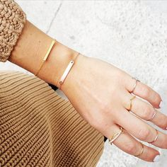 <this petite stacking situation...> feat. #wanderlustandco V-Stack Band x Knot Ring x Helix Ring x Box Bracelet x Name-Plate Petite Bracelet via @wethepeople123