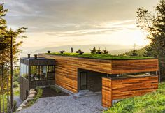 Mu Architecture created this incredible hill-top residence that demonstrates how elegant design can be fused with energy efficiency. Dubbed Malbaie V residence, the four-bedroom building is embedded in the rocky hillside of Cap-à-l'Aigle within the region of Charlevoix, Quebec, Canada. The residence is encased within a red cedar exterior and topped with a living planted roof that insulates the building and helps to control rainwater runoff.