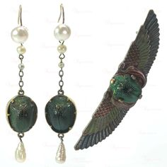 Egyptian revival brooch and earrings set, brass, enamel, and real scarab beetles. Around 1920. The earrings are probably make-ups.