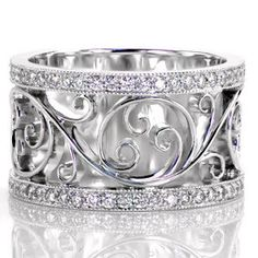 Catalina - Flowing hand wrought filigree seamlessly flows within our Catalina design. The curving 14k white gold swirls form a beautifully balanced design. The curls are framed by two delicate  micro pavé diamond bands. The design balances polished metal work with glimmering diamonds for an eye catching piece.