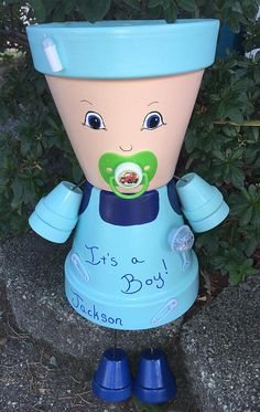 Clay Pot People Planters, Flower Pot People, Unique BabyShower Centerpiece, Its a Boy, Its a Girl  Description--- This Garden Friends listing is for a Unique hand painted clay Baby pot person made from terracotta pots. You can chose boy, girl, pink, blue, green, purple...any color you like. Tell us what you have in mind or which example from the pictures you like and we will create it. We can personalize your baby with Its a Girl, Its a Boy, a name or small message. A baby Pot Person makes…