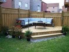 corner deck for a fire pit AWAY from the house... hmmm this is doable. ;)