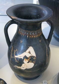 Pelike (two-handled urn with flat bottom) depicting an acrobat shooting an arrow with her feet. Greece 4th century BC. [640x909]