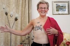 For some women, tattoos over their mastectomy, surgery or breast reconstruction scars can help them move forward after breast cancer. Breast Cancer Tattoos, Breast Cancer Survivor, Pink Ribbon Tattoos, White Flower Tattoos, Iris Tattoo, Scar Tattoo, Design My Tattoo, Holly Black