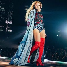 Queen @beyonce wearing a custom #RobertoCavalli total look designed by @peter_dundas while performing at #TheFormationWorldTour in Stockholm, Sweden. The look is made of a leather, denim and printed silk patchwork and embroidered denim coat; worn over a black silk lace and denim jeans bodysuit with multicolor velvet applications embroidered with crystal and tribal decorations. The look is accessorized with a pair of thigh high red patent platform boots. #Beyonce #CavalliCat #CavalliGirl