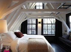 Maison Rika in Amsterdam: loft feel with exposed ceiling beams painted in white.