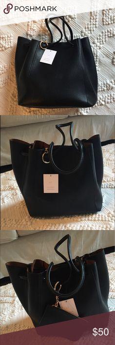 LAUREN CONRAD Black Bucket handbag. NWT LAUREN CONRAD Black Bucket handbag. NWT. Never been worn! LC Lauren Conrad Bags Shoulder Bags