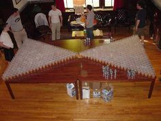 beer pong table...awesome. i wanna play with this many cups!!