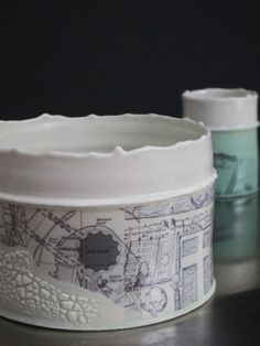 Raewyn Harrison -  Mud Larking Vessels: thrown porcelain with slip casting, crawling glaze and ceramic transfers. Images combine modern map with elizabethian map. D 20cm x H 15cm.