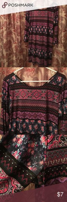 Wetseal patterned shift dress. Size XL. Wetseal patterned shift dress. Size XL. 94% polyester 6% spandex. Line dry for care. Slight wear in the arm area on one side but other than that great condition. Super comfy! Cute cut out back! Wet Seal Dresses
